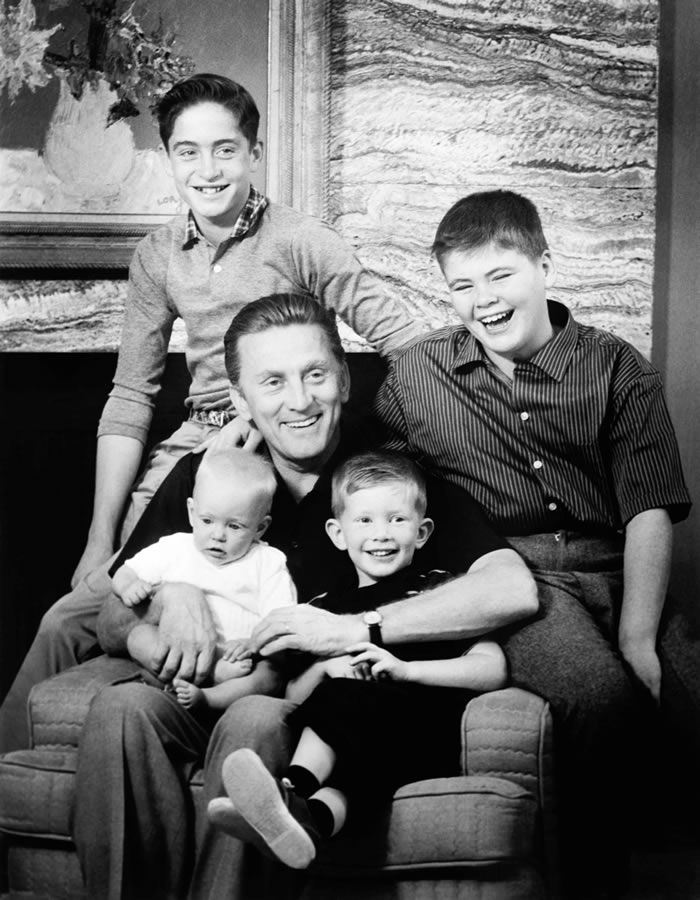 Mr. Douglas in 1959 with his sons, clockwise from top left, Michael, Joel, Peter and Eric. All his sons went into the film business.Credit...Associated Press