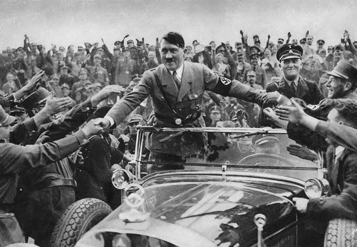 Adolf Hitler, chancellor of Germany, is welcomed by supporters at Nuremberg in 1933.Credit...Hulton Archive/Getty Images