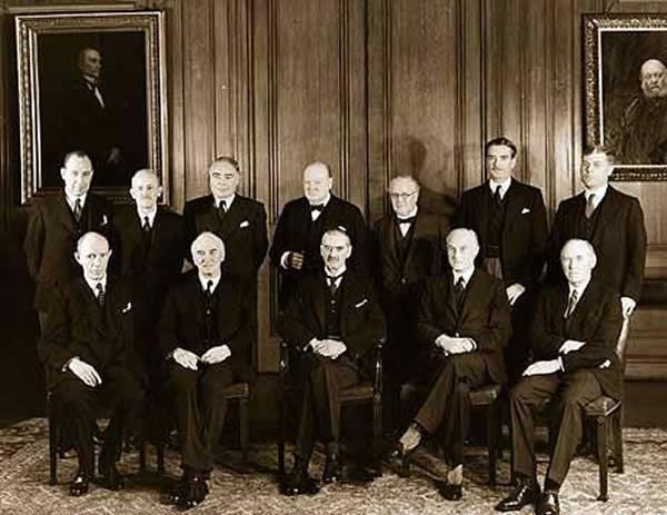 The British War Cabinet with Sir John Anderson , Mr Leslie Hore-Belisha, Mr Winston Churchill (1849-1895), Sir Kingely Wood, Mr Anthony Eden (1897-1977), Sir Edward Bridges, Lord Halifax, Sir John Simon and Sir Neville Chamberlain (1869-1940)