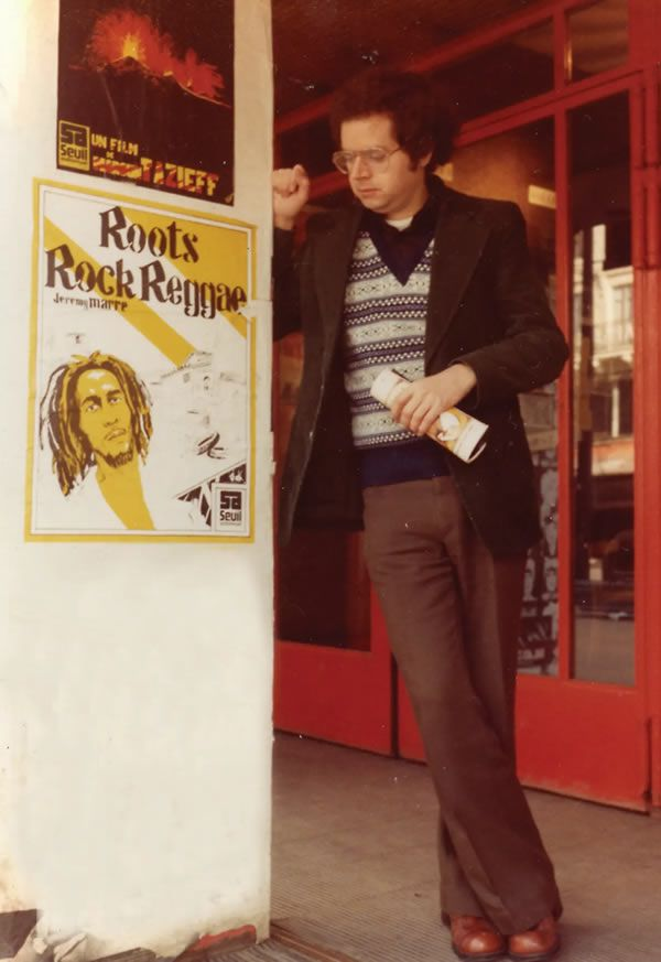 Jeremy Marre in Jamaica in the 1970s with a poster for his film Roots Rock Reggae