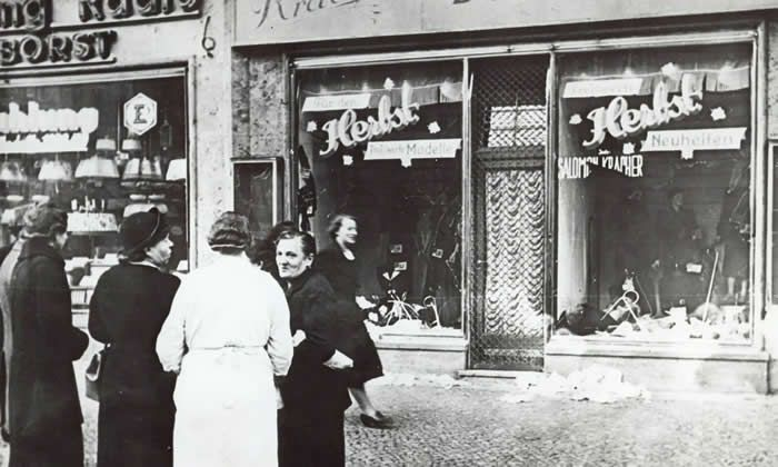 In November 1938 a group of people stand outside a Jewish-owned shop in an unnamed German town after the Kristallnacht, a night of Nazi-incited mass riots against Jewish people and property. Photograph: AP