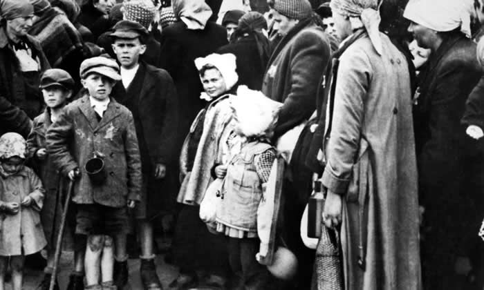 Jewish women and children get off trains at their arrival in Auschwitz extermination camp. Photograph: AFP/Getty Images