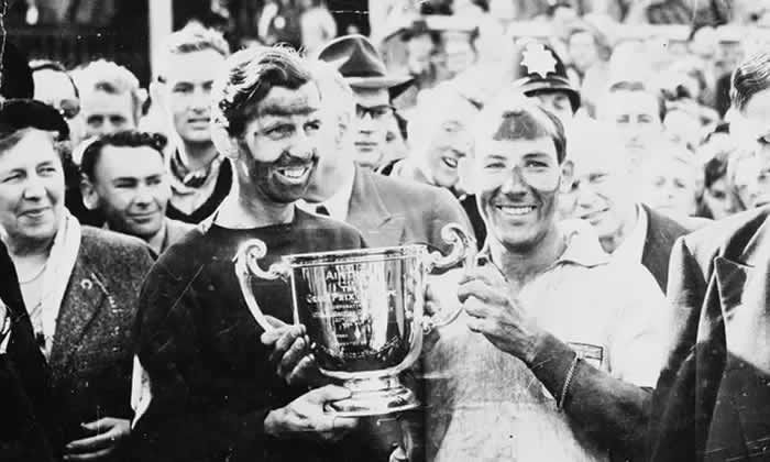 Stirling Moss, right, and his team-mate Tony Brooks, after winning the British Grand Prix at Aintree, 1957. Photograph: Keystone/Getty Images