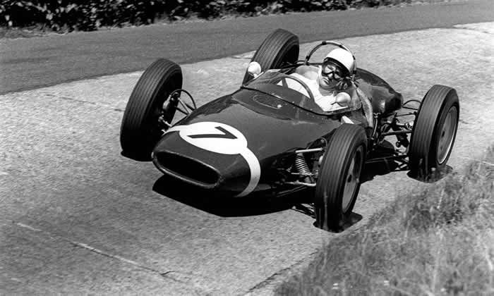 Stirling Moss driving a Lotus-Climax 18 in the German Grand Prix at the Nürburgring, 1961. Photograph: Bernard Cahier/Getty Images
