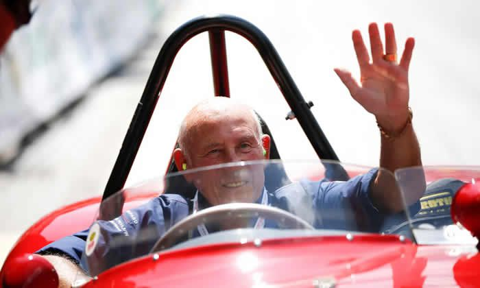 Stirling Moss waves to spectators from his 1955 Ferrari 750 Monza during the Ennstal Classic rally in Austria, 2013. Photograph: Leonhard Föger/Reuters