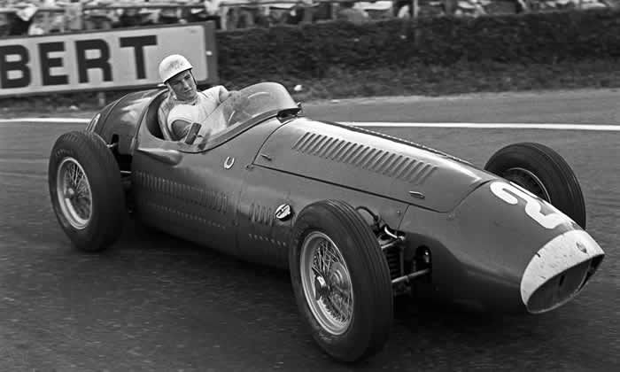 Stirling Moss competing in the 1954 Belgian Grand Prix in a Maserati 250F. Photograph: Bernard Cahier/Getty Images