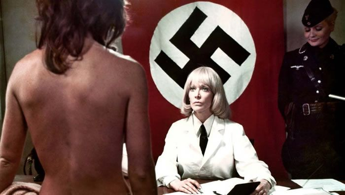 "Dyanne Thorne in ""Ilsa: She Wolf of the SS"" (1975). The film and her character, a Nazi doctor with a taste for sex and torture, became cultural touchstones of sorts.Credit...Cambist Films, via Photofest"