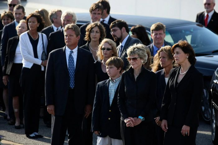 Ms. Smith, in foreground in sunglasses, with other members of the Kennedy family during the funeral for Senator Edward M. Kennedy, her younger brother, in 2009.Credit...Chang W. Lee/The New York Times