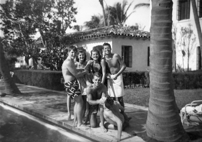 The Kennedy family in Palm Beach, Fla., in about 1948. Standing, from left, were Edward, Jean, Patricia and John. Robert was kneeling. With them, sitting, was a family friend, Joe Gargan.Credit...John F. Kennedy Presidential Library and Museum, Boston.
