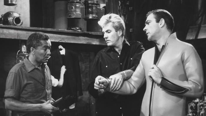 Earl Cameron (L) in a scene from the 1965 Bond movie Thunderball with Rick Van Nutter (C) and Sean Connery (R)