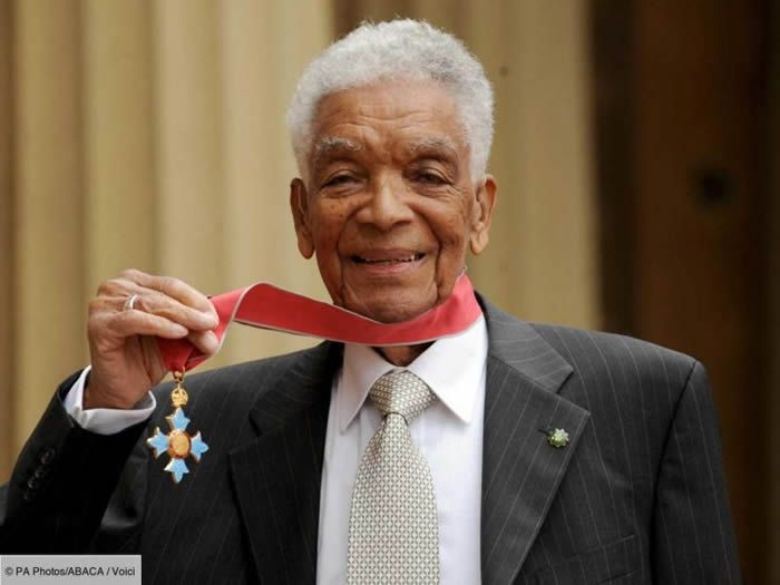 Earl Cameron outside Buckingham Palace with his CBE, which he received in 2009