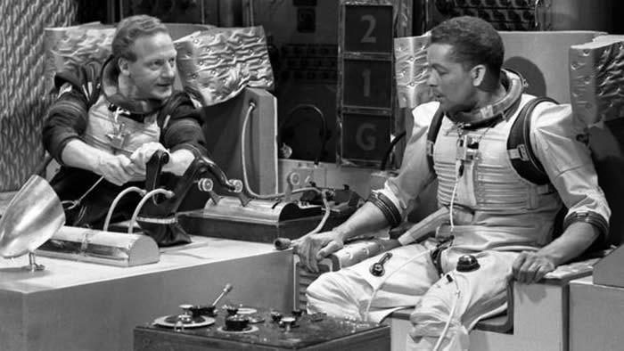 "Alan White as Schultz and Earl Cameron as Williams in a scene from ""Dr Who and The Tenth Planet"""