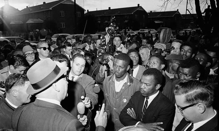 John Lewis, front with arms folded, in Selma in 1965. Photograph: Anonymous/AP