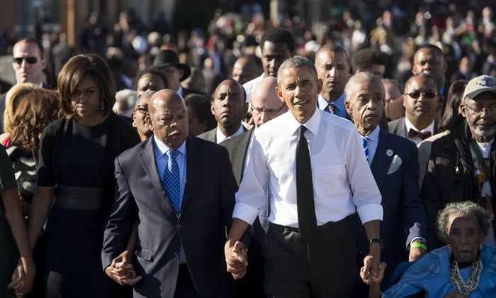 Barack Obama walks alongside Lewis across the Edmund Pettus Bridge in 2015 to mark the 50th anniversary of the Selma to Montgomery marches in Selma, Alabama. Photograph: Saul Loeb/AFP/Getty Images