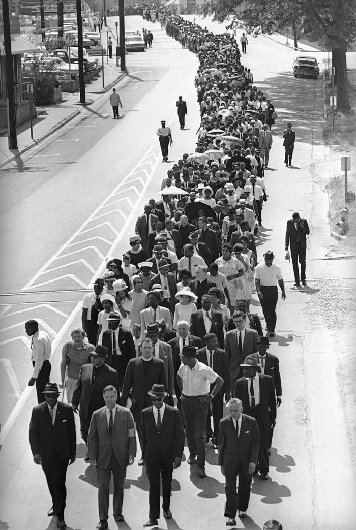 Mr. Evers, far left in foreground, led a march in Jackson, Miss., in 1966 to mark the third anniversary of Medgar Evers's assassination. With him were, from left, the lawyer John S. Stillman, Roy Wilkins of the N.A.A.C.P. and the lawyer R. Jess Brown.Credit...Associated Press