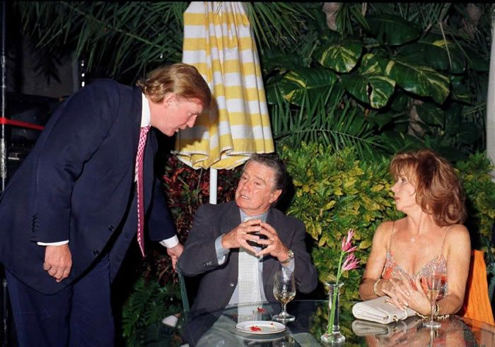 Donald Trump with Regis Phibin and his wife, Joy at Mar-a-Lago in 2000| Davidoff Studios/Getty Images