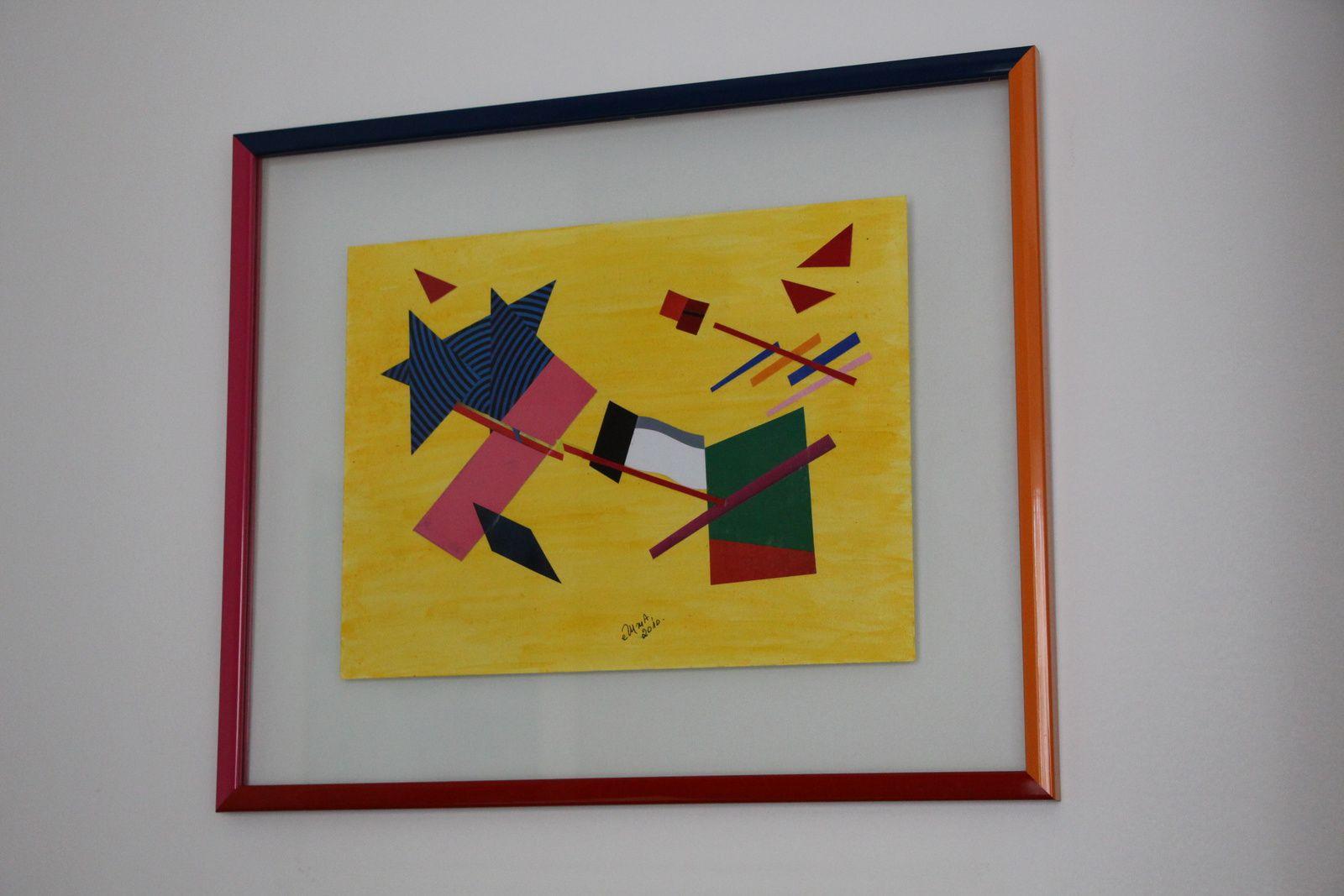 J'ai confié l'encadrement à une spécialiste : sur plexis, 4 baguettes de couleurs différentes, réalisé par colorisdeco : www.colorisdeco.fr
