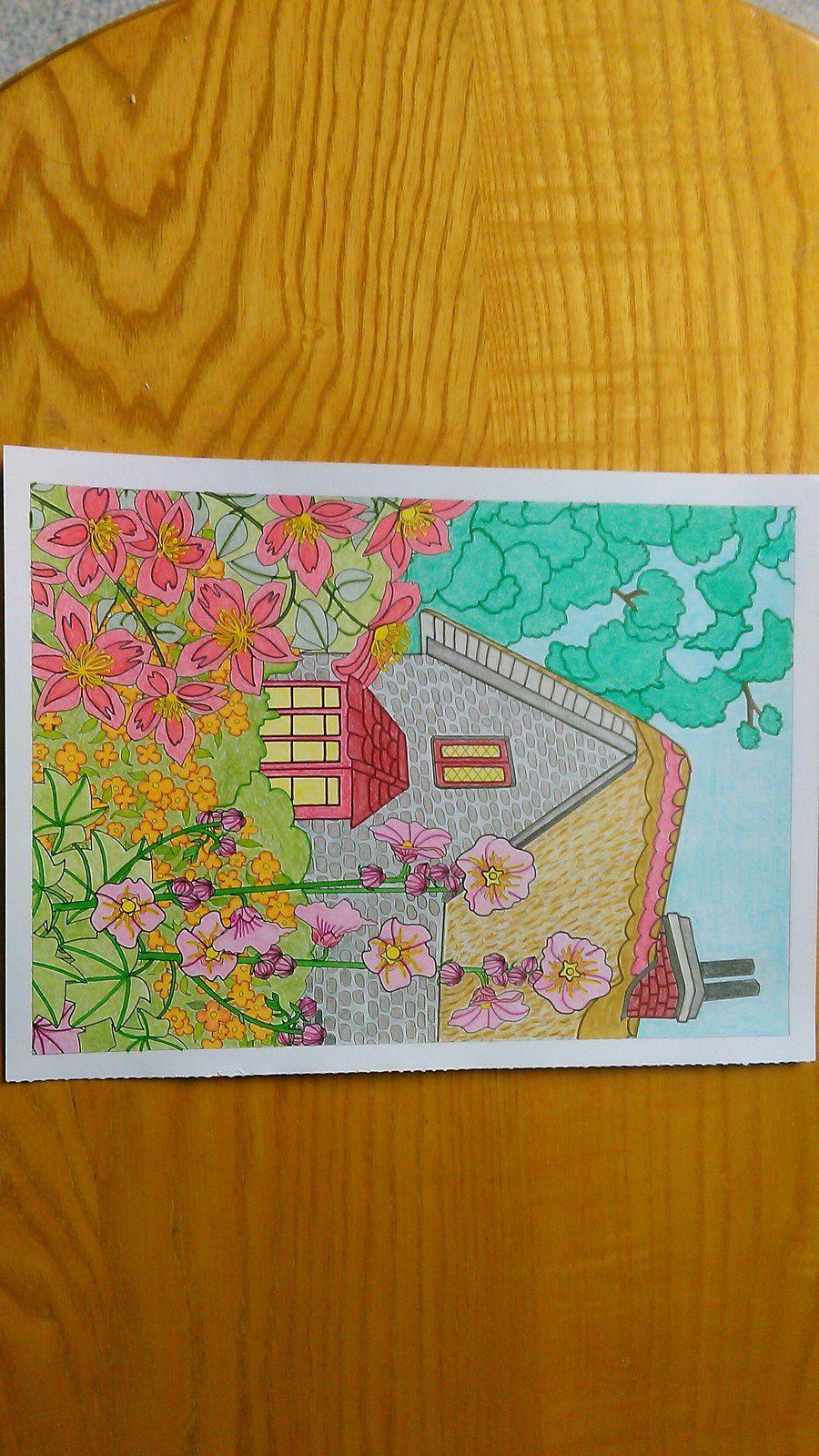 6ème coloriage : Une maison au milieu des fleurs