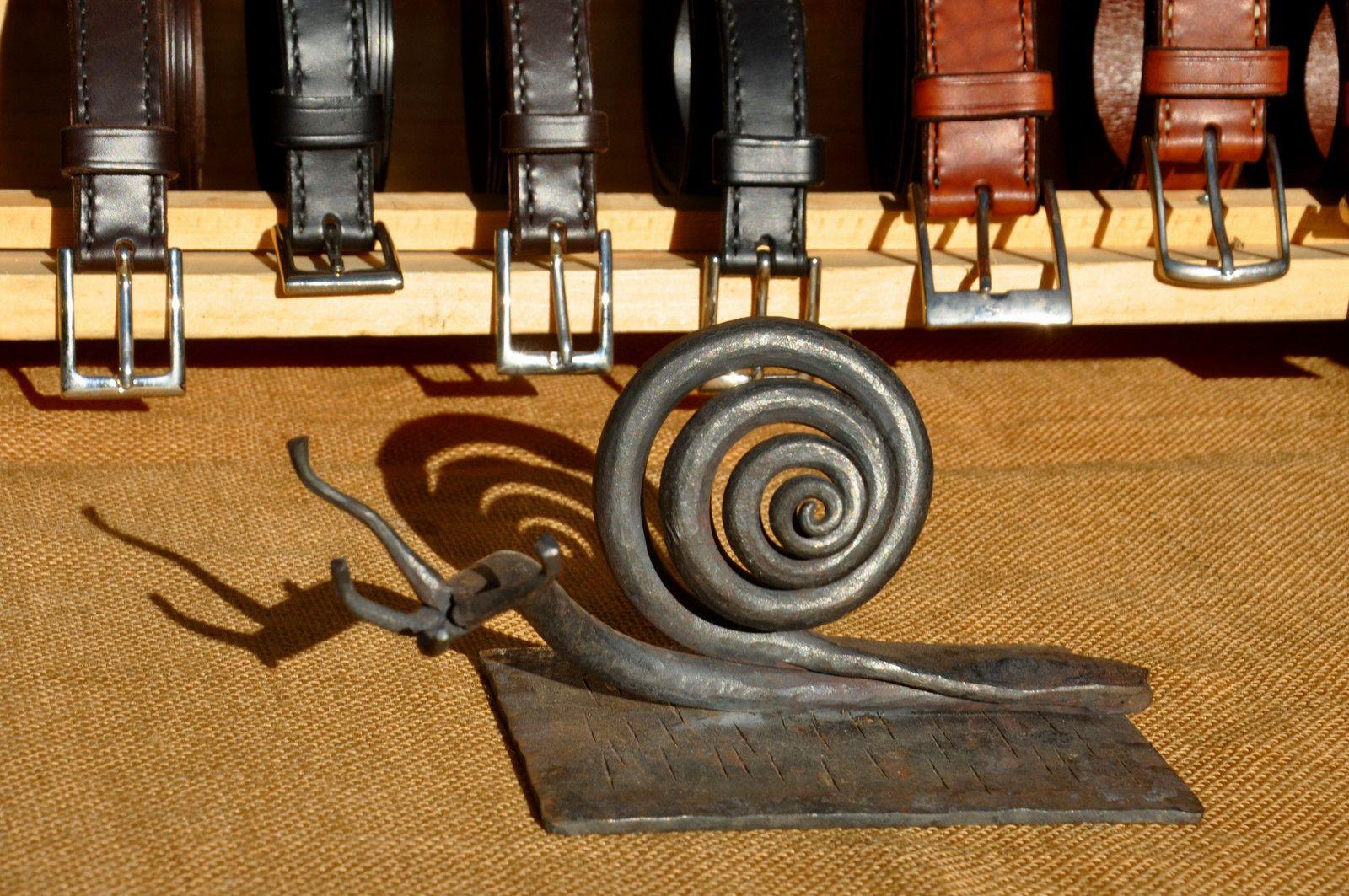 Escargot en fer et le travail du cuir.