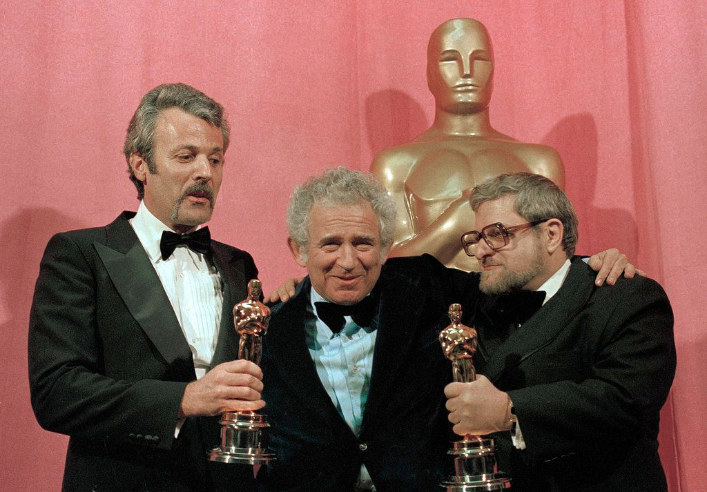 "Norman Mailer, center, presented the writing Oscars to Mr. Goldman, left, for ""All the President's Men"" (best adapted screenplay) and Paddy Chayefsky for ""Network"" (best original screenplay) at the 1977 Academy Awards.CreditPendergrass/Associated Press"