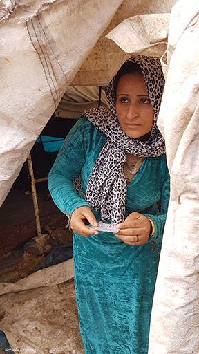 Distribution de cartes alimentaires Bim dans le camp de réfugiés d'Adana, 26 décembre 2016