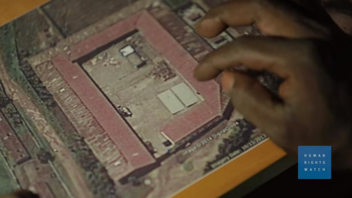 A former Gikondo detainee uses a satellite image of the transit center to indicate which rooms were used for different categories of detainees, when he was there.
