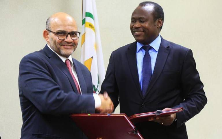December 12, 2018: World Bank Country Manager Yasser El-Gammal (left) and Minister for Finance and Economic Planning Dr Uzziel Ndagijimana exchange documents after signing an MoU in Kigali. Such signings are a regular feat in Kigali between Rwandan and WB officials.