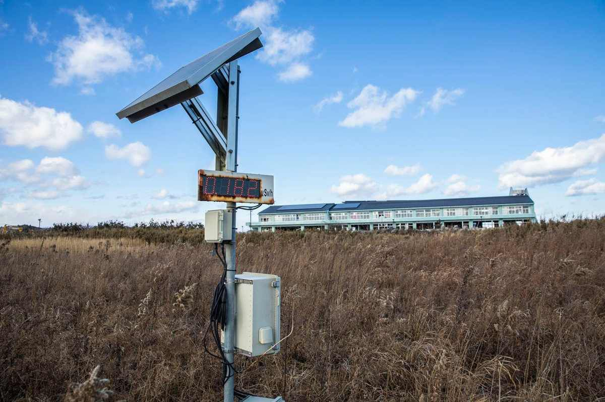 A radiation-monitoring device stands in front of Ukedo Elementary School in Namie. (Shiho Fukada for The Washington Post)
