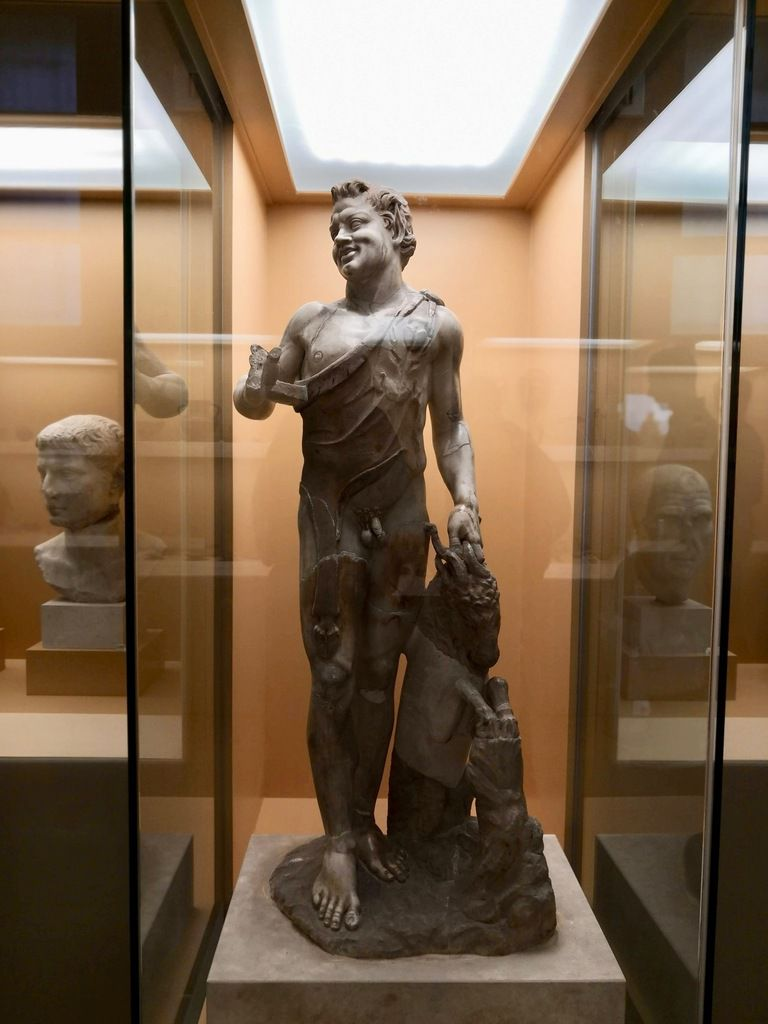 Marble statue of a youthful satyr with a Pan's pipe, holding a goat ca. 150 A.C.