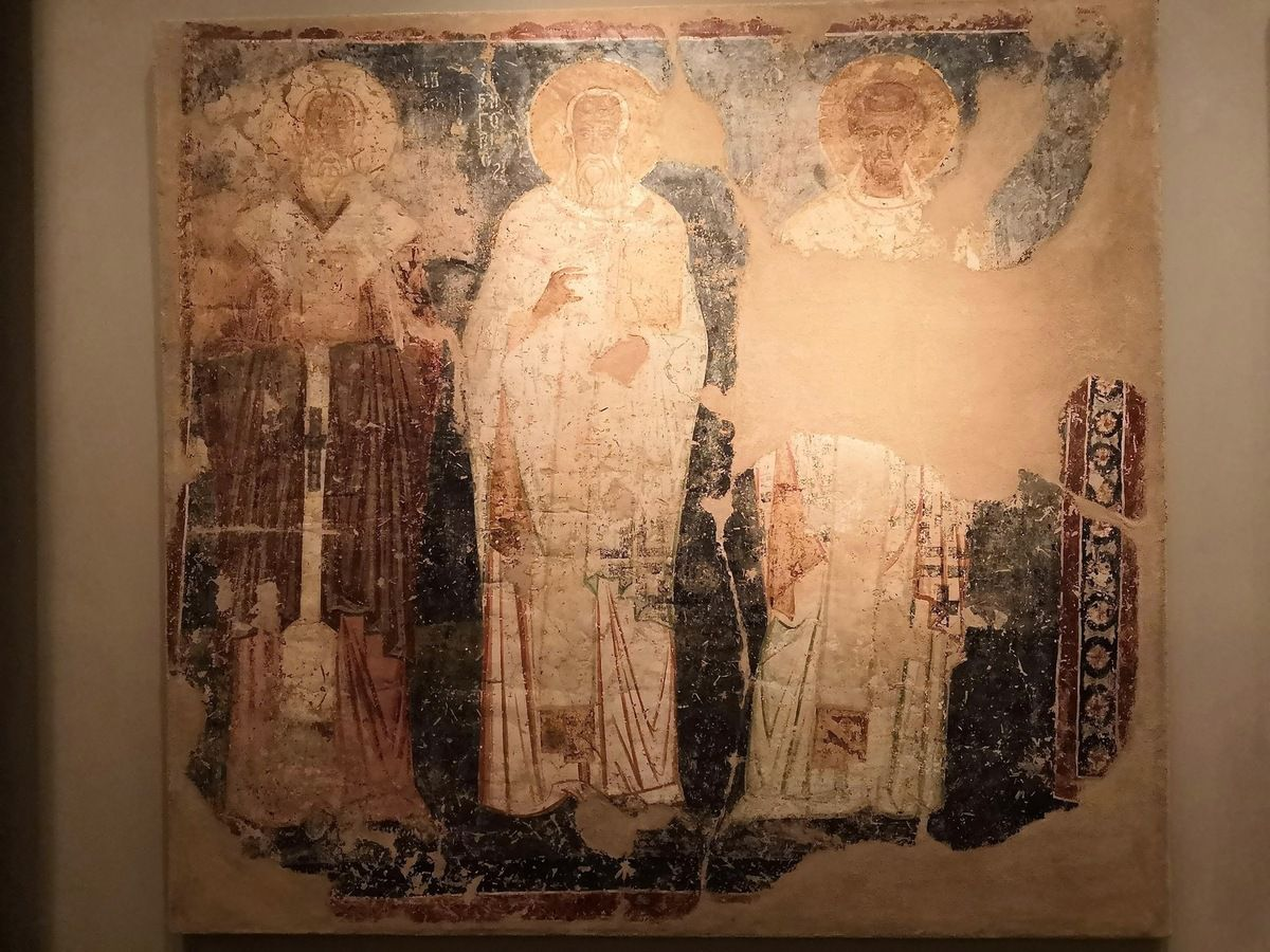 Sanctuary wall paintings with officiationg Church fathers and Saint Stephen (?). Oropos, Attica, Church of Saint George. 1240-1250.
