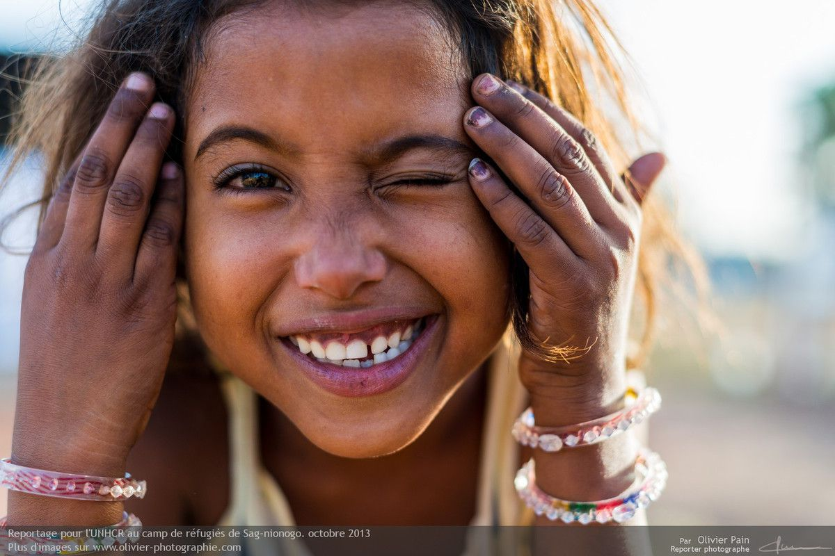 This photo is the last one I took of her. Her smile and her eyes are full of joy and happiness. When I took this photo I did not know her story. I later learned through her friend's mother that Aisha is an orphan and that her parents were killed in front of her.