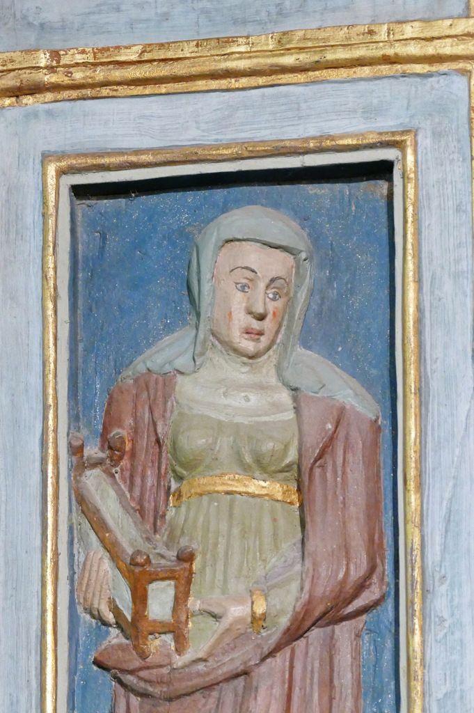 La Sibylle de Samos et son berceau, volet gauche du retable de l'Arbre de Jessé, bois polychrome, vers 1576-1580,   chapelle Notre-Dame-de-Berven. Photographie lavieb-aile juillet 2017.