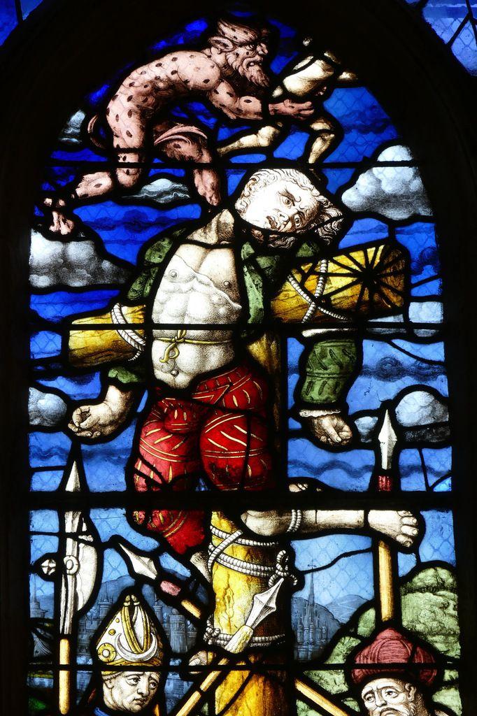 Le Mauvais Larron, lancette droite de la Crucifixion (1539), maîtresse-vitre de l'église Saint-Yves de La Roche-Maurice. Photographie lavieb-aile septembre 2017.