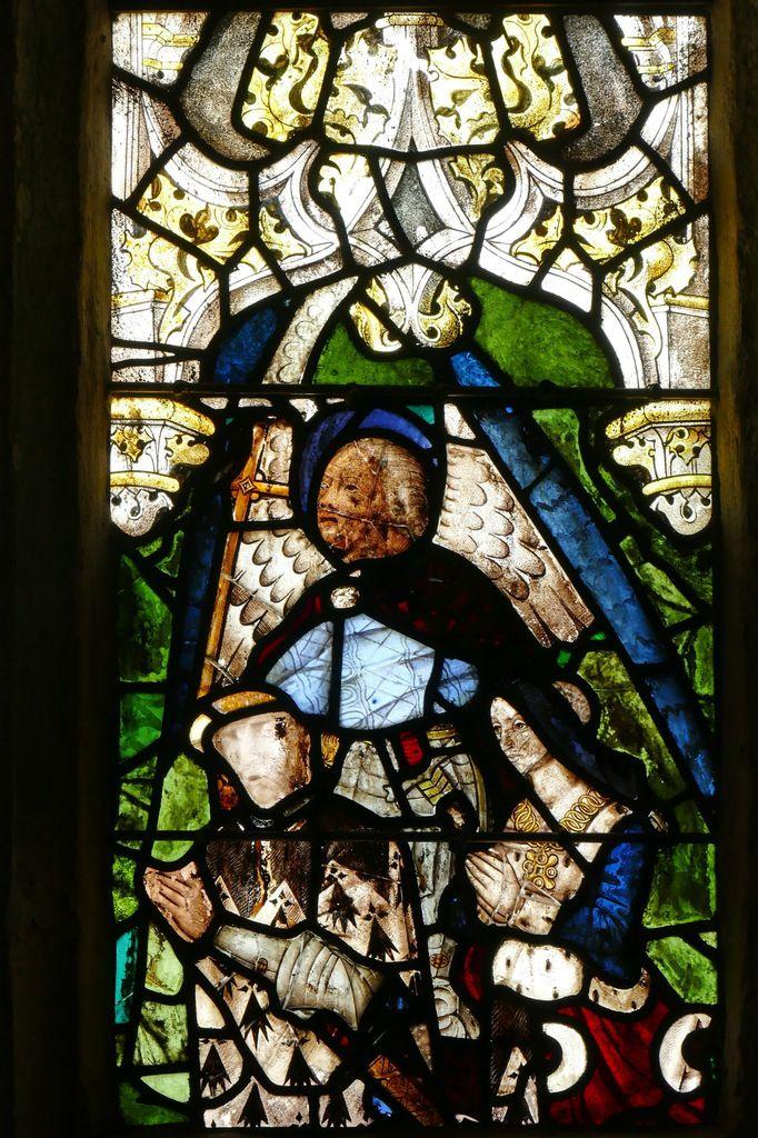 Saint Michel et un couple de donateurs, (vers 1500), baie 4 de l'église de Guengat. Photographie lavieb-aile 2017.