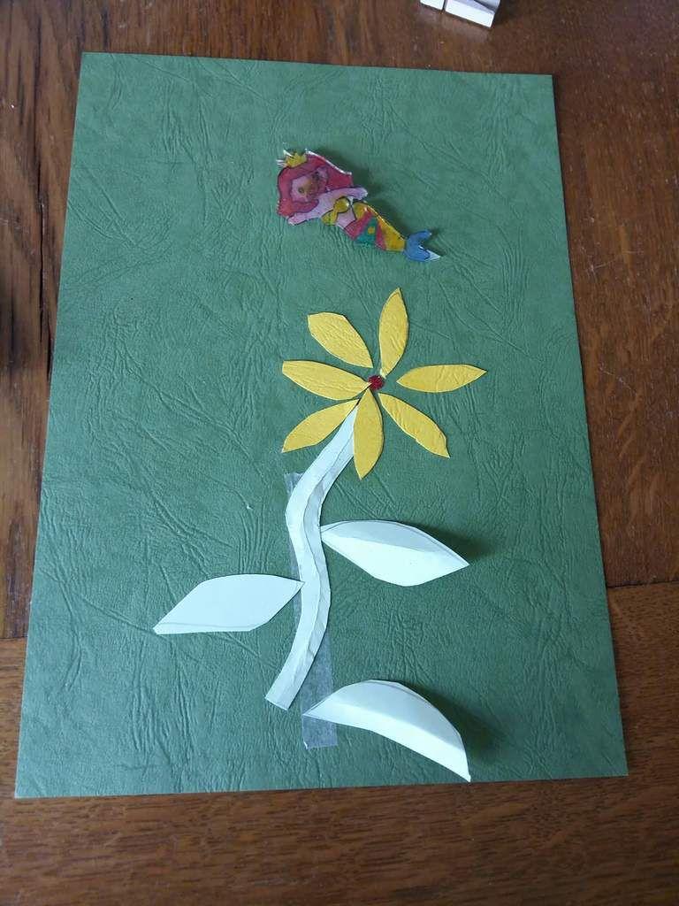 Voici la fleur de Nell qui s est arrêté  en chemin car malgré  bientôt 6 ans elle a tenu trois heures autour d une table elle a fini par saturer