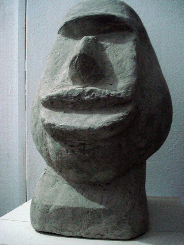 sculpture tête primitive en ciment