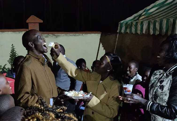 Iten, Thursday, November 8th, 2018. Mary Keitany feeds her husband, Charles Koech, small meals, before an array of guests, during a party which took place in her own garden, in order to celebrate her victory, a few days earlier, at the New York marathon.