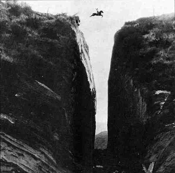 In this incredible photograph from 1923, silent film star Tom Mix (more likely a stunt double) jumps over Beale's Cut  in the lost silent 'Three Jumps Ahead'.