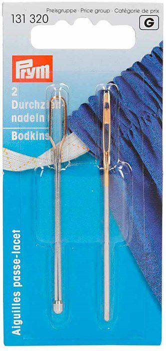 chez prym: deux passe-lacet différents dans une boite.