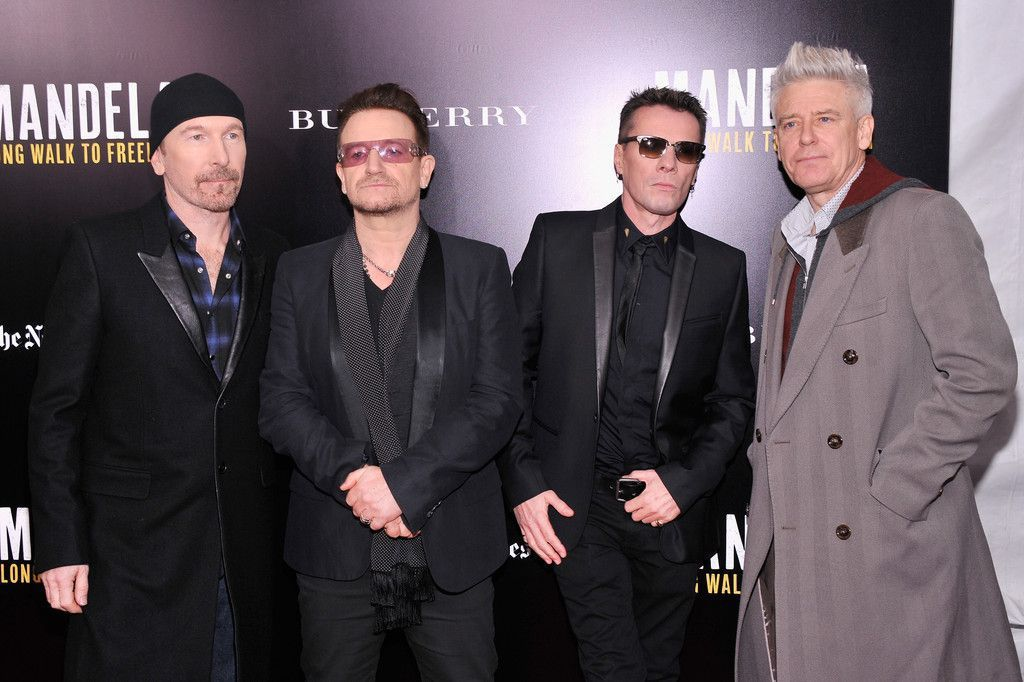 U2 assiste à la projection de 'Mandela: Long Walk to Freedom.