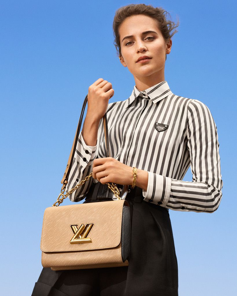 ALICIA VIKANDER AND LÉA SEYDOUX WERE CAPTURED BY ALBERT MOYA WITH THE LATEST SELECTION OF LOUIS VUITTON'S NEW HANDBAGS