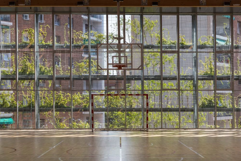 TURÓ DE LA PEIRA'S SPORTS CENTER AND LAYOUT OF THE INTERIOR URBAN BLOCK IN BARCELONA, BY ANNA NOGUERA AND JAVIER FERNANDEZ ARCHITECTS