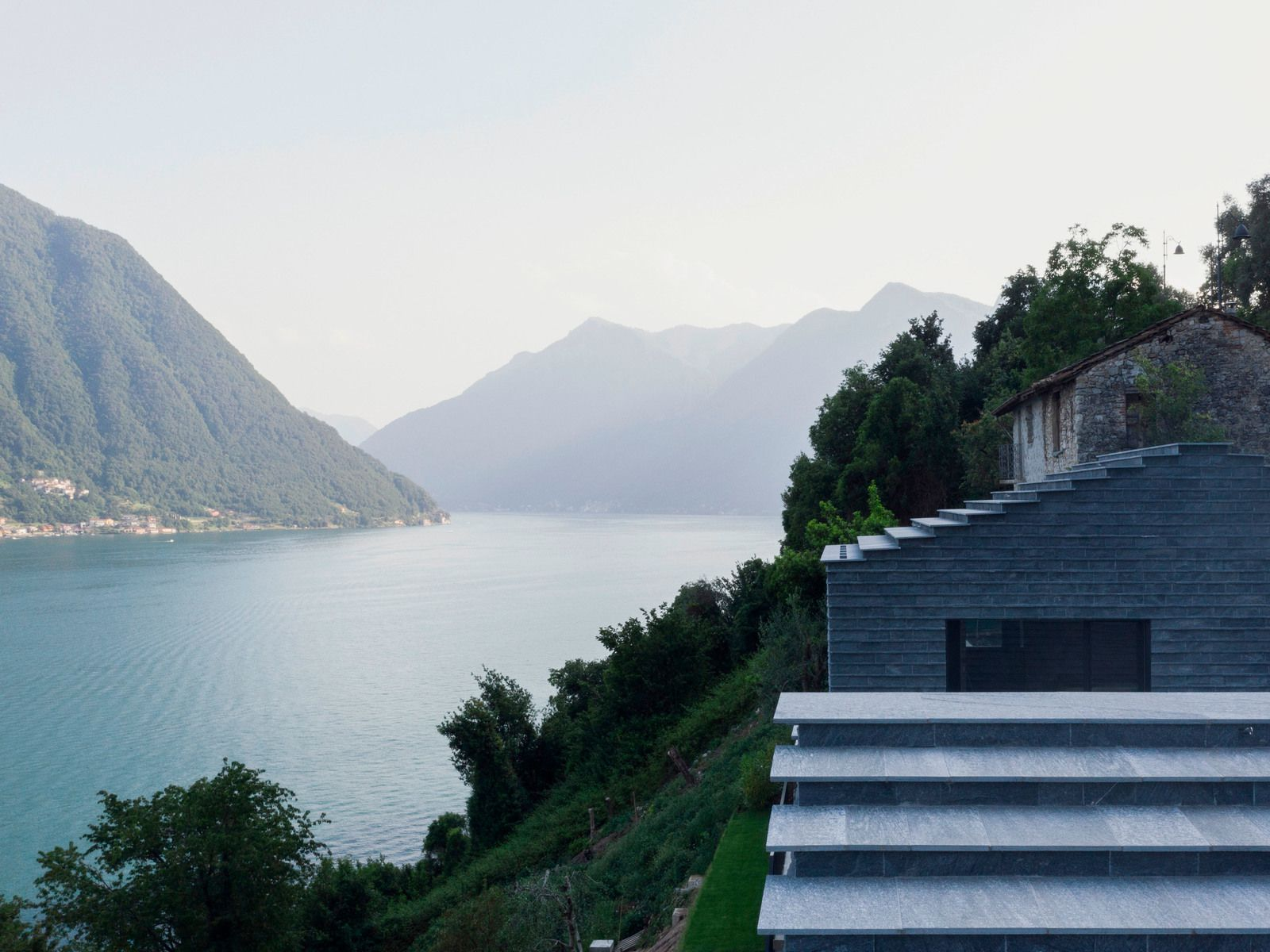 A STONE HOUSE, BETWEEN THE LAKE AND THE FOREST. DISCOVER THE VILLA MOLLI IN ITALY, BY THE ARCHITECT LORENZO GUZZINI