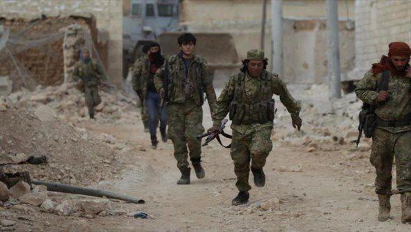 Miembros de los grupos armados en Siria.