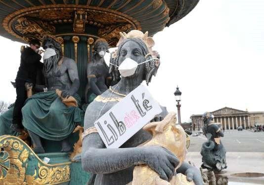 Action pour dénoncer la pollution de l'air, place de la Concorde, à Paris, le 31 mars 2018. JACQUES DEMARTHON / AFP