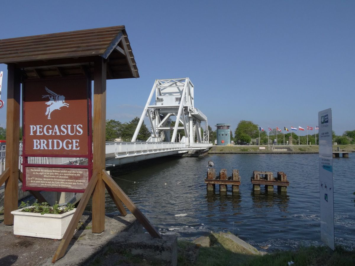 Pegasus Bridge. The original structure is displayed in the museum, located just behind the current bridge.