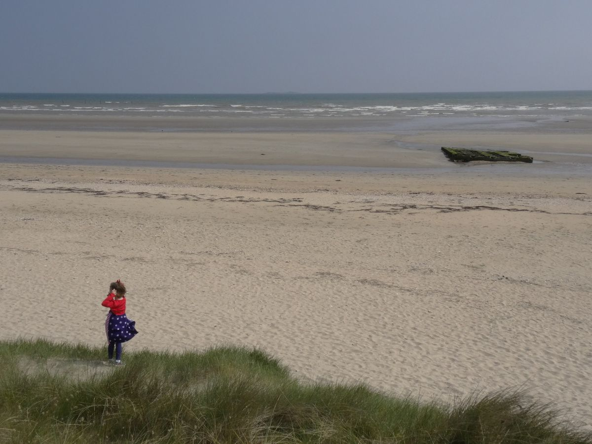 Utah Beach. The little girl's dress was an added symbol !
