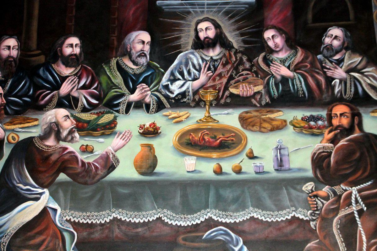 A l'interieur de la Cathédrale, un grand tableau de la Cène avec au milieu de la table un cochon d'inde roti