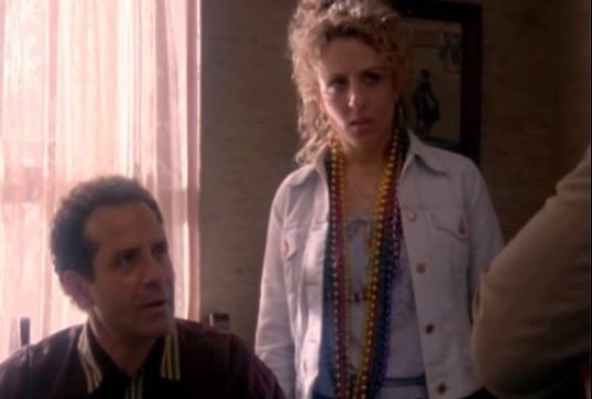 """It's the drug cartel"" says the cop and Sharona roams around with a bribe around her neck that the cop will eventually accept."