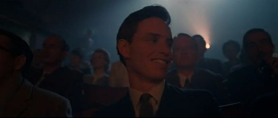 He's reassured by the audience's light hearted reaction to Marilyn's provocative show.